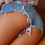 Craving Carmen shows off her country side and her tight little ass in short jean shorts